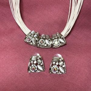 Costume jeweled silver slides on white cords